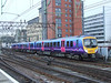 185137 departing Glasgow Central on a working to Manchester Airport