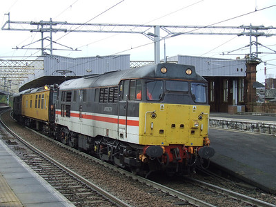 31454 passing through Paisley Gilmour Street with the overhead line test coach Mentor in Intercity livery