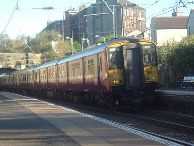 318253 drawing into Johnstone on an Ayr service