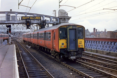 318250 departing Glasgow Central on a service to Largs