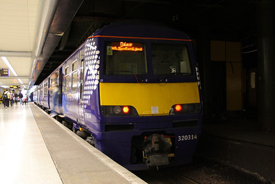 320314 at P8 of Glasgow Queen Street Low Level on a Dalmuir working sporting it's recently acquired Transport Scotland Saltire livery