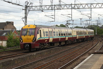 334026 on a working to Gourock crossing Wallneuk Junction at Paisley Gilmour Street