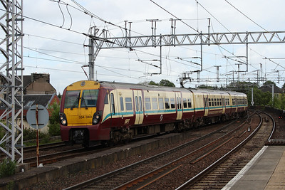 334040 on a working to Gourock crossing Wallneuk Junction at Paisley Gilmour Street