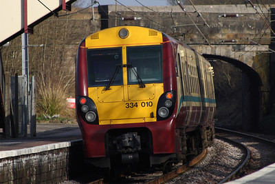334010 departs Johnstone on a Glasgow Central service