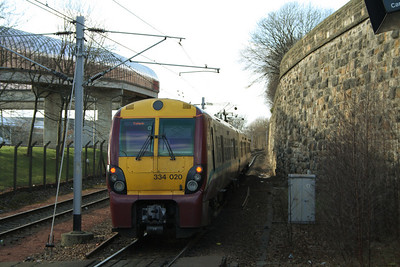 334020 departing Exhibition Centre with a service for Dalmuir