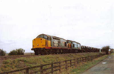 37501 Teeside Steelmaster and 37502 British Steel Teeside with a strip coils train. Both locos are still in operation with DRS as 37601 and 37602