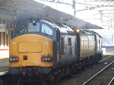 37612 passing through Paisley Gilmour Street with the Network Rail overhead line test coach Mentor
