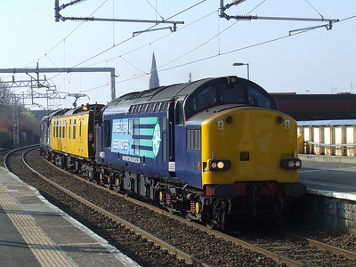 37069 passing through Paisley Gilmour Street with the Network Rail overhead line test coach Mentor