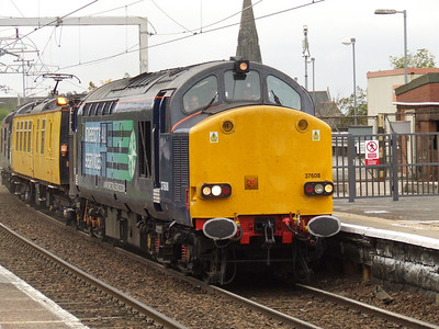 37608 passing through Paisley Gilmour Street with the Network Rail overhead line test coach Mentor