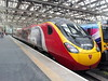 390155 <i>X-Men Days of Future Past</i><br> Glasgow Central (High Level)<br> Glasgow<br> 08/07/2014<br> <i>This was the Pendolino that had the X-Men Day of Future Past livery on it. This was my only sighting of it.</i>