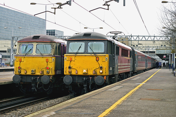 87004 and 87002 Milton Keynes Central 5/3/2005 87004: 1F20 1500 London Euston-Liverpool Lime Street 87002: 1B48 1430 Birmingham New Street-London Euston