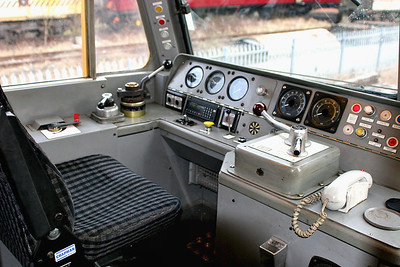 A: Cab No2 of 57303, Drivers side. From left to right: Brake Control Switch, Straight Air Brake, Proportional 'Train' Brake, fault lights, engine start/stop switches, air/brake guages, NRN radio, fire test button, wiper control, AWS reset, horn, AWS 'sunflower', Speedometer, Engine Rev Dial, Power Handle and reverser lever, Parking Brake condition light, ETS light and switches, Hazard warning light, NRN handset.