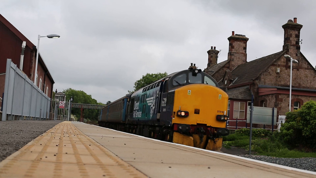 37218 and 37402 departing Ravenglass with 2C41 1437 Barrow-in-Furness to Carlisle