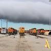 BNSF Locomotives line up under storm clouds at Lincoln Diesel shop, NE
