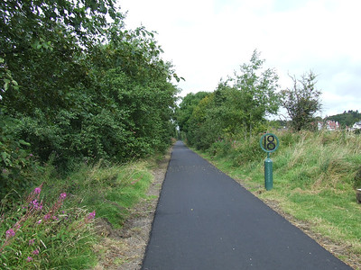 Looking west along the trackbed towards Kilmacolm from Route Marker 18 on the cycle track that sits on the trackbed