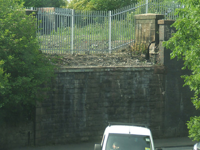 The gap where the bridge that once spanned Kilmacolm Road was, it was removed in April 2009, meaning that the line to the Container Terminal has now been severed. It may be that the bridge was removed due to maintenance (or lack of) issues, so a new bridge needed if the line was re-opened.