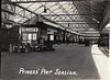 View inside Princes Pier station sometime during the 1920's, the office having Glasgow and South Western Railway written on it, and a poster for the LMS behind the milk churns.