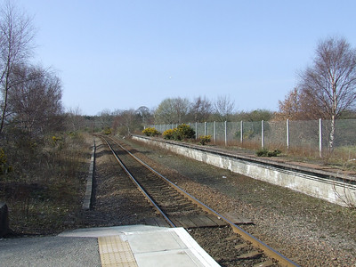Forres Station, looking towards Inverness. To the right is the disused Aberdeen platform, and behind it is the former goods yard that stood at the station. The Inverness & Perth Junction railway from Aviemore came in from the left
