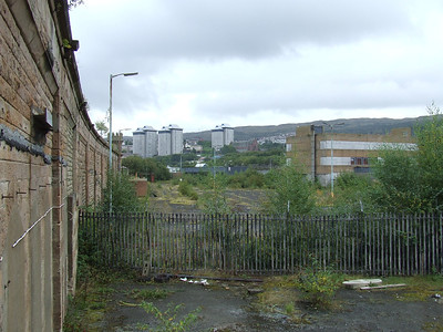 Looking east over the site of the former goods yard at Greenock Central. The yard ran as far as the camera position. Now empty, its most recent use was as a BT depot