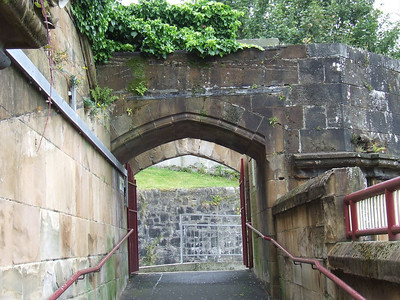 Terrace Road entrance at Greenock Central seen from the platform 2 stairway. This entrance was once covered, with the original doorway the nearer of the two openings.