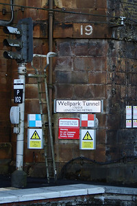 Warning and information panels and signal at the mouth of Wellpark Tunnel at Greenock Central