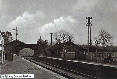 Glenluce Station, view looking towards Newton Stewart. The station was opened in 1861 as part of the Portpatrick Railway (from Portpatrick to Castle Douglas). It closed in 1965. It was operated by the Caledonian Railway from 1864 to 1885, and from 1885 became part of the Portpatrick & Wigtownshire Joint Railway, owned by  Caledonian, Glasgow & South Western, London & North Western and Midland railways. It later became part of the LMS. The line was closed in stages; Portpatrick to Stranraer in 1950 and from Challoch Junction to Castle Douglas in 1965. The station  has been cleared and built over, no trace remianing, although the overbridge in shot still remains.
