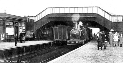 James Stirling engine No. 224 of the 221 Class of Glasgow & South Western Railway arriving at Troon Station. The station was built by Glasgow & South Western Railway on the Troon Loop Line, and this is the newer Troon station which opened in 1892, replacing the original Troon station which was closed the same day. The previous station was on the Glasgow, Paisley, Kilmarnock and Ayr Railway. The line was retained for through workings but is now closed and the old station site and goods yard is now a housing estate.