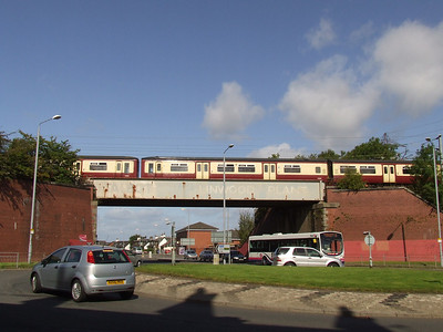 The railway bridge at Linwood Tool on the main Paisley to Johnstone line in Paisley. A Class 318 unit crosses the bridge.