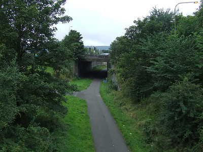Looking West from the location of the signal box at Paisley West with the line curving away to the right. The line went from here to Corsebar Junction and Elderslie. Corsebar Junction was immediately beyond the road bridge on Maxwellton Street in centre of shot, where the line went off to the left to Barrhead on the G&SWR Barrhead Branch (Potterhill Branch)