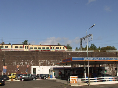 The raised viaduct passing Ferguslie with a Class 334 unit heading towards Glasgow