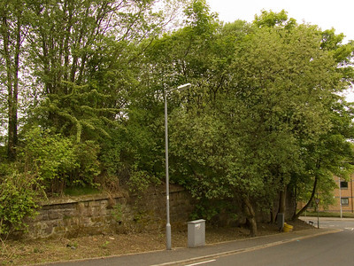 Victoria Road in Paisley. The is part of the remaining trackbed running up to the abutment of the bridge that crossed Corsebar Road on the G&SWR Barrhead Branch (Potterhill Branch). Behind the new flats is the remaining trackbed that ran that came from Meiklerigs Junction where it connected to the Paisley Canal Line via Corsebar Junction and Potterhill Junction. The Potterhill Branch opened in 1902 as a circular route from St Enoch to Barrhead via Paisley and the Glasgow, Barrhead and Paisley Joint Railway (and was to be in competition with the Caledonian Railway Paisley & Barrhead District Railway). However, this only lasted until 1907 when it was discontinued, and trains contiued to Barrhead via Nitshill, and via Paisley to Barrhead Central. The line from Potterhill to Barrhead closed in 1913 to passengers, and in 1917 the route closed completely to passengers. Bus and tram use meant the line was never popular and it was unprofitable. This was the same reason the Caledonian route was never used by passengers. In 1909 Corsebar Junction to Barrhead was singled and the signal boxes closed meaning Meiklerigs Junction was abolished and Potterhill Junction on the Paisley Canal Line was closed and lifted. The Potterhill Branch lasted until 1970, being used for freight during this time.