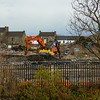This is the clearance work and demolition in progress of the former Ciba-Geigy pigmention factory in Hawkhead in Paisley. The factory was built on the land that used by the Paisley and Barrhead District Line. It crossed the White Cart River at this point. The abutments of the bridge remain in place on both sides of the river.