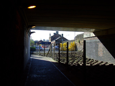 Looking West from Paisley Canal station towards the original Paisley Canal Street station which is under the bridge at Causeyside Street. The trackbed here has been filled in and is now used as the carpark for Platform 1 which resides in the Paisley Canal Street station buildings. Note the wire runners on the wall.