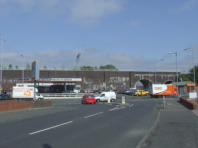 Near Ferguslie Station in Paisley. The railway viaduct here used to have arches before it was filled in.