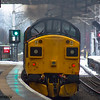 37025 <i>Inverness TMD</i><br> Scottish Railway Preservation Society<br> (BR large logo livery)<br> Paisley Gilmour Street<br> 18/01/2016<br> <i>Seen passing through Paisley Gilmour Street en route to Cardiff from Bo'ness. It would normally have travelled by the West Coast Mainline, but as this was blocked by the closure of Lamington Viaduct it was diverted via Barassie Junction and the Glasgow & South Western Mainline. It is on short term hire to Colas Rail after being main line certified.</i>