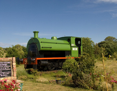 A Peckett 0-4-0 tank engine at Beal level crossing on the site of the former station (closed in 1968), along with other railway memorabilia