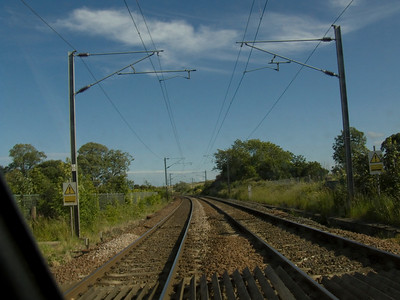 Looking South at Beal level crossing on the site of the former station which closed in 1968