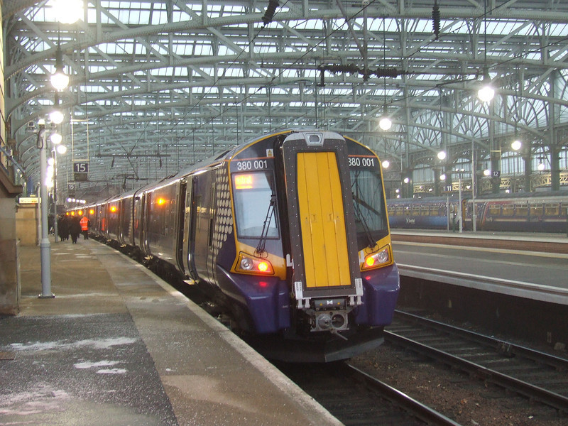 380001 at the rear of a Class 380 set having arrived at Glasgow Central.