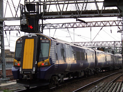 380106 at the rear of service 2Z03 departing from P14 at Glasgow Central