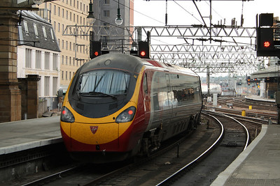 390031 'City of Liverpool' departing for London Euston