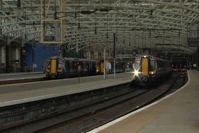 380007 departing on a working for Gourock