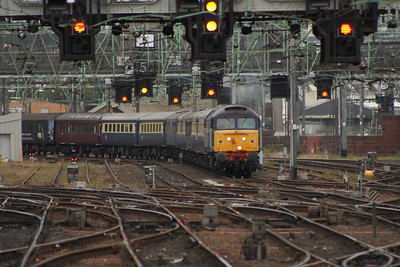 47841 passing under the signal gantries with working 5Z59 with a Crusie Saver Special running empty stock from Crewe to Glasgow Central