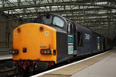 37607 at the rear of service 5Z59 with a Crusie Saver Special running empty stock from Crewe to Glasgow Central at P10