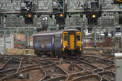 156505 passing under the signal gantries as it draws into Glasgow Central