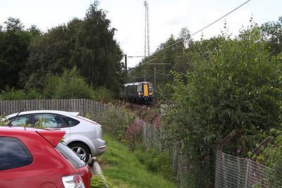 380105 passing through Elderslie with a Glasgow Central service