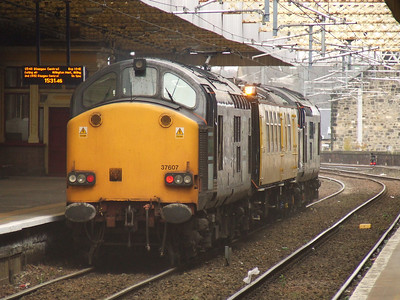 37607 at the rear of the Network Rail test train Mentor passing through Paisley Gilmour Street