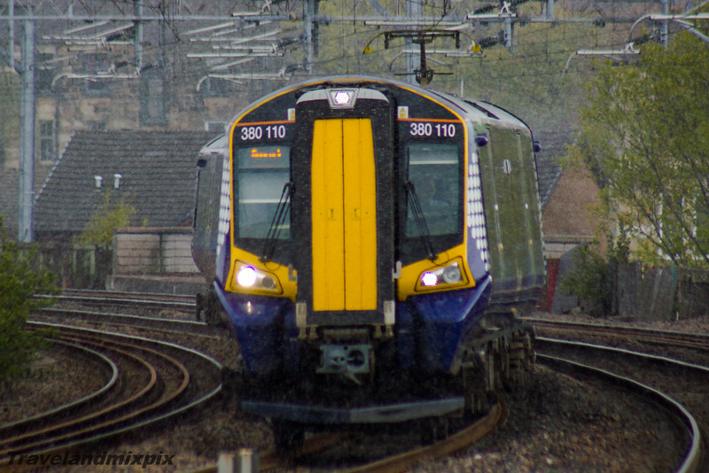 380110<br> Scotrail<br> Paisley Gilmour Street<br> 27/04/2016<br> <i>Drawing into Paisley Gilmour Street in unseasonably late snow flurries</i>