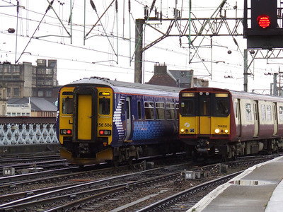 156504 departs Glasgow Central on a working to Kilmarnock passing 314210