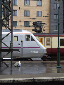 New East Coast livery on show, as modeled on their coaching stock led by DVT 82202 at Glasgow Central