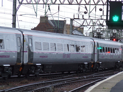 New East Coast livery on show, as modeled on their Mark 4 coaching stock led by DVT 82202 at Glasgow Central